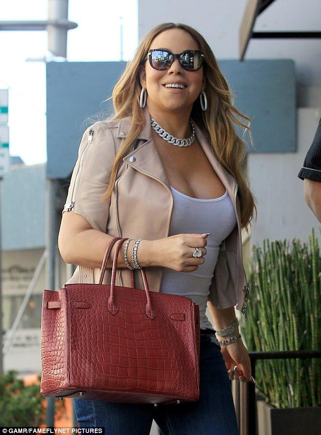 Boc gia mau tui dat do duoc Mariah Carey mang theo moi noi hinh anh 3