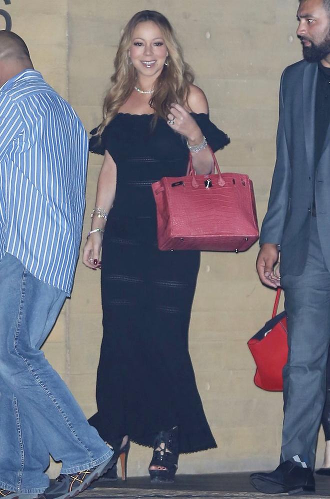 Boc gia mau tui dat do duoc Mariah Carey mang theo moi noi hinh anh 5