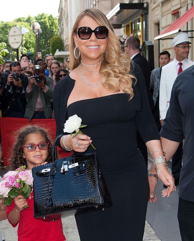 Boc gia mau tui dat do duoc Mariah Carey mang theo moi noi hinh anh 6