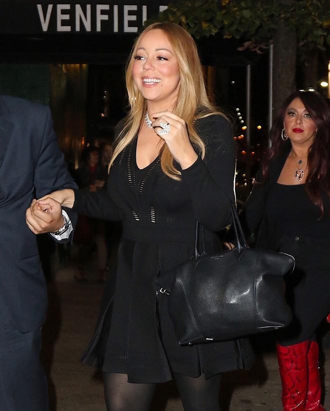 Boc gia mau tui dat do duoc Mariah Carey mang theo moi noi hinh anh 7