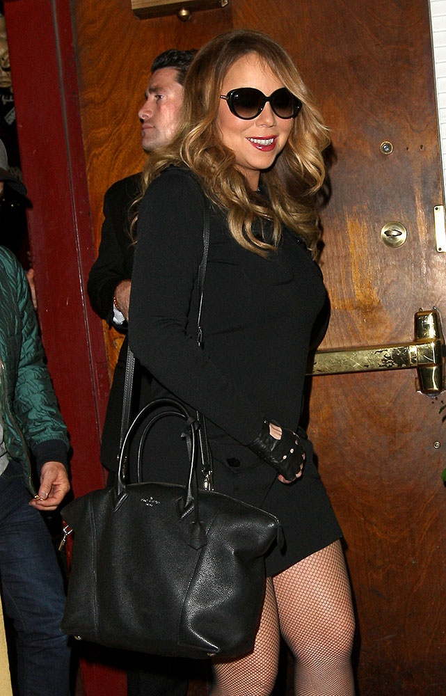 Boc gia mau tui dat do duoc Mariah Carey mang theo moi noi hinh anh 8