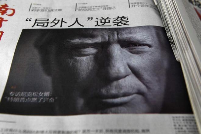 Bao Trung Quoc lon tieng doa dam Trump hinh anh 1