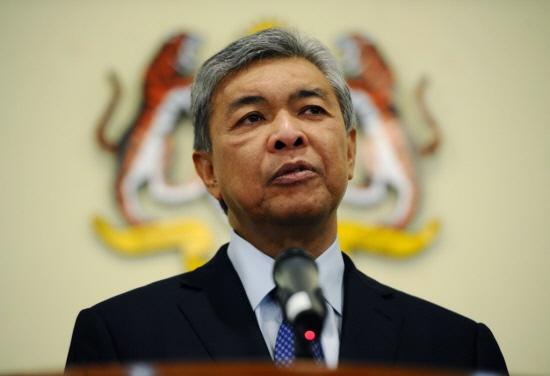 Malaysia tra dua, cam nhan vien su quan Trieu Tien xuat canh hinh anh