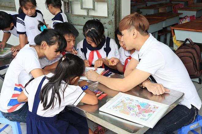 Nguyen Vu vui voi 500 hoc sinh ngheo o TP.HCM hinh anh 2