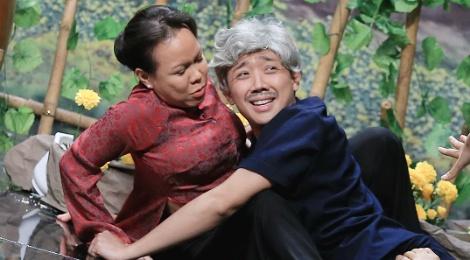 Tran Thanh - Viet Huong te nga tren san khau nghieng hinh anh