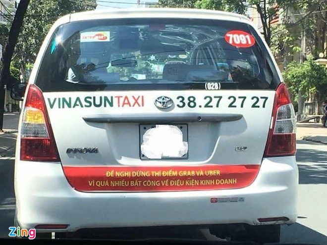 Bung no taxi dan khau hieu phan doi Uber, Grab hinh anh