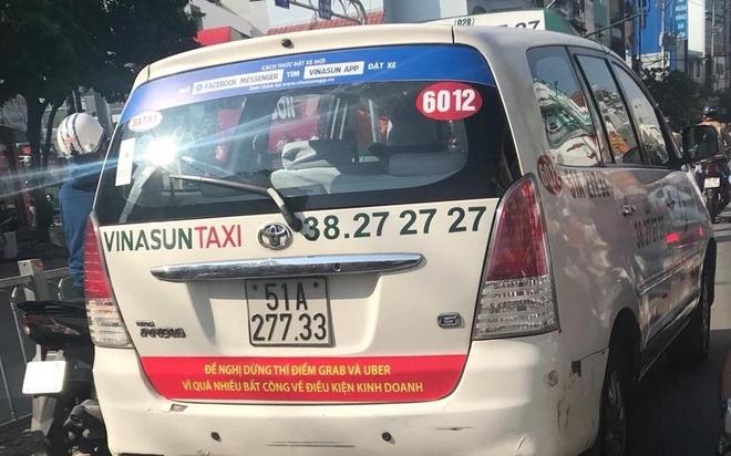 Taxi dan khau hieu phan doi Grab, Uber da vi pham Luat Canh tranh? hinh anh