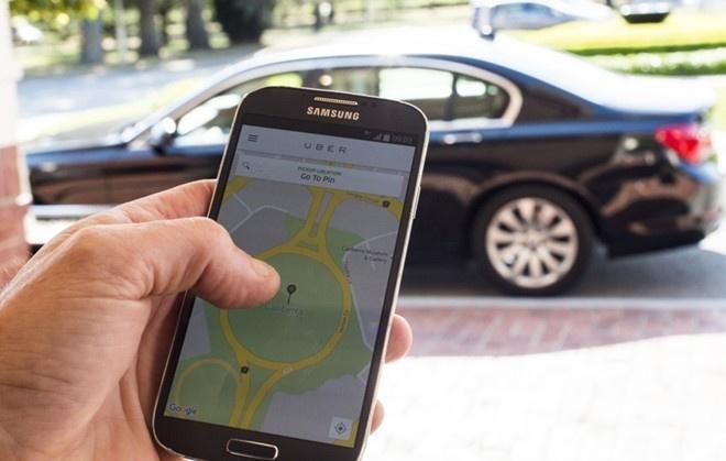 Bo Giao thong Van tai doc thuc dan logo cho xe Uber, Grab hinh anh