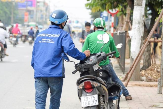 Bo Tai chinh: Grab phai tra thay so tien no thue cua Uber hinh anh