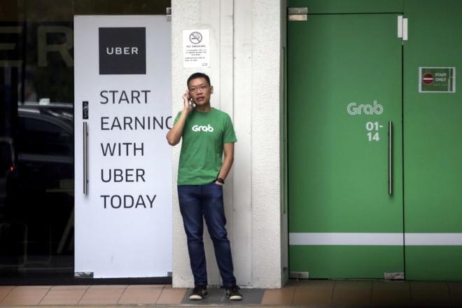 Bo Cong Thuong dieu tra tiep dau hieu pham phap cua vu Grab mua Uber hinh anh