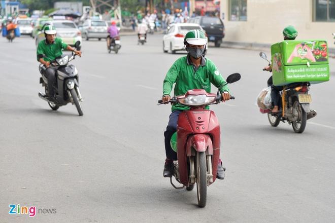Grab noi se dong 500 ty dong tien thue tai Viet Nam nam 2018 hinh anh