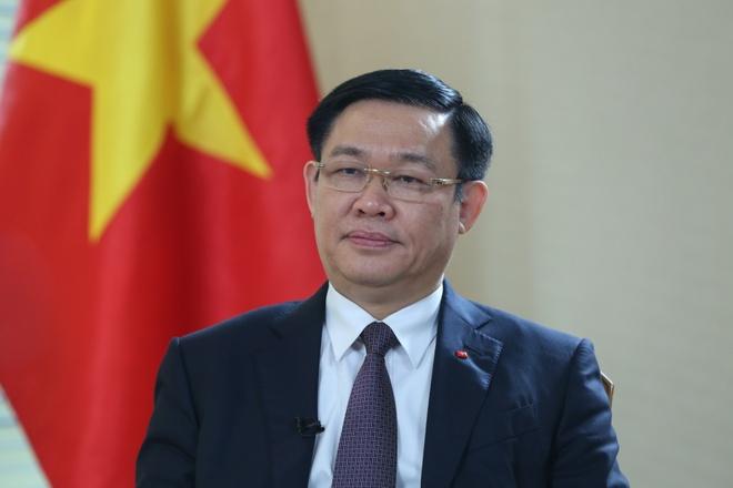 PTT Vuong Dinh Hue: 'Ca nuoc dang thuc hien hieu qua muc tieu kep' hinh anh