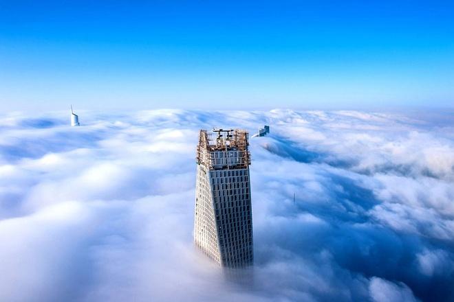 """Nhung buc anh 'Chi co the la Dubai' hinh anh 5 Với những công trình kiến trúc chọc trời, Dubai lôi cuốn và huyền ảo với thành phố cổ tích """"trên mây""""."""