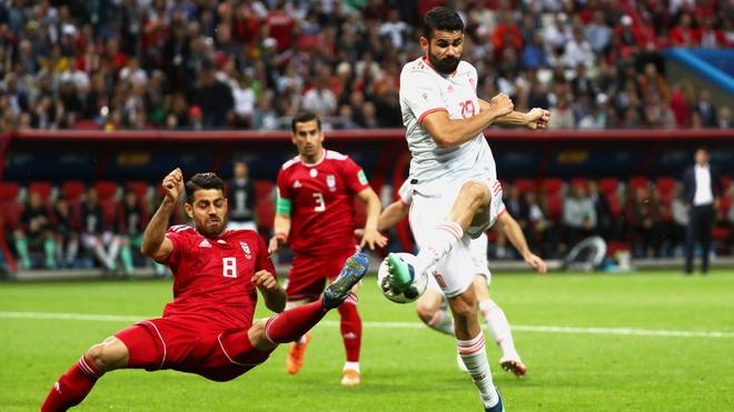 Costa may man ghi ban, Tay Ban Nha chat vat thang Iran 1-0 hinh anh