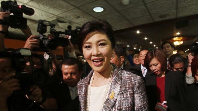Sau Bac Kinh va Nhat Ban, Yingluck va Thaksin toi Hong Kong hinh anh