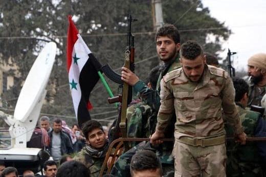 Syria tai chiem thanh cong Douma sau cao buoc tan cong hoa hoc hinh anh