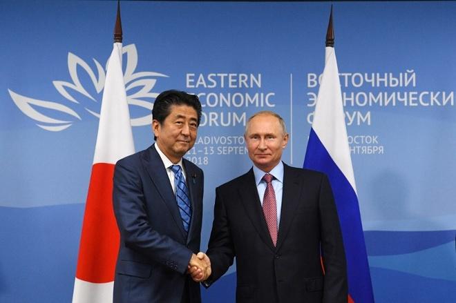 Ong Abe, Putin thao luan de som ky hiep dinh hoa binh hinh anh 1