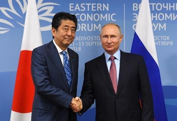 Ong Abe, Putin thao luan de som ky hiep dinh hoa binh hinh anh