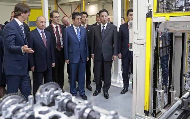 Ong Abe, Putin thao luan de som ky hiep dinh hoa binh hinh anh 2