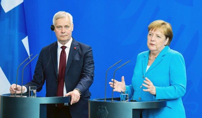 Ba Merkel len tieng trong hop bao 1 tieng sau con run ray lan 3 hinh anh 1