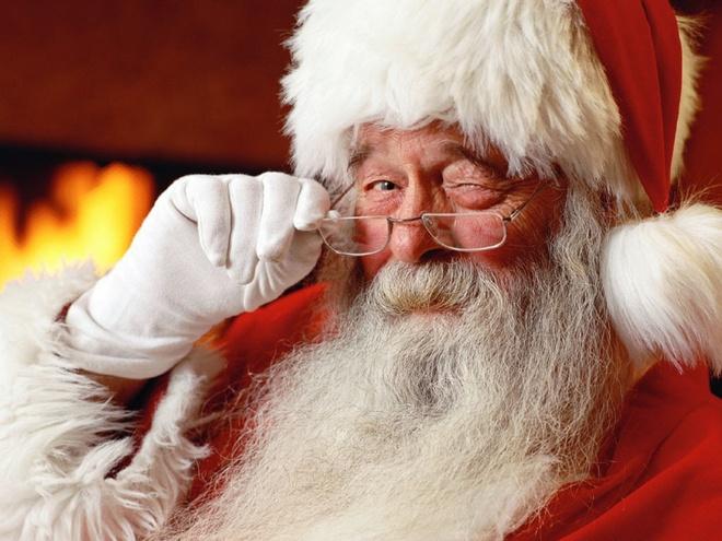 Tai sao ong gia Noel lai mac quan ao mau do hinh anh