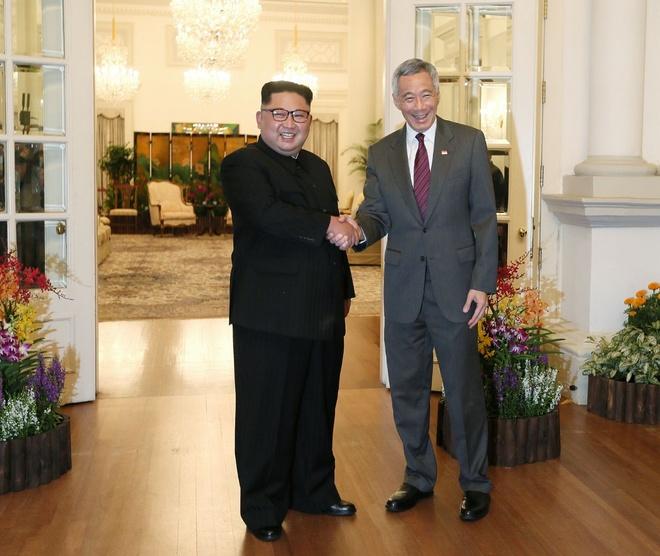 Ong Kim Jong Un gap Thu tuong Singapore Ly Hien Long hinh anh 2