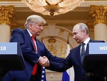 Trump bi chi trich 'yeu kem' truoc Putin trong cuoc gap thuong dinh hinh anh