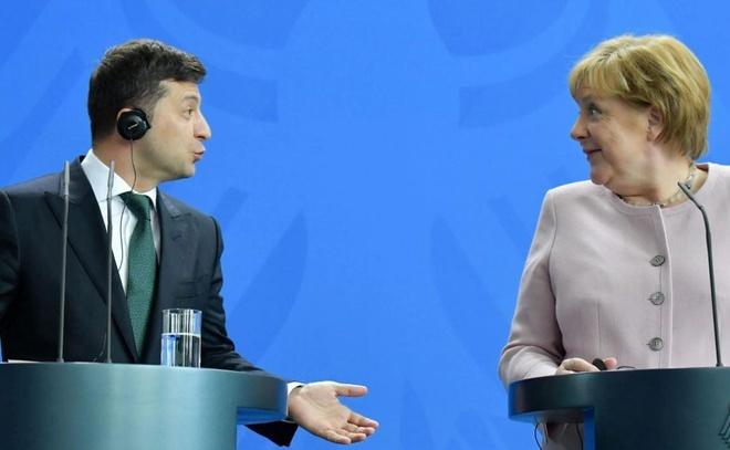 Thu tuong Merkel run lay bay o le chao co voi tong thong Ukraine hinh anh 2