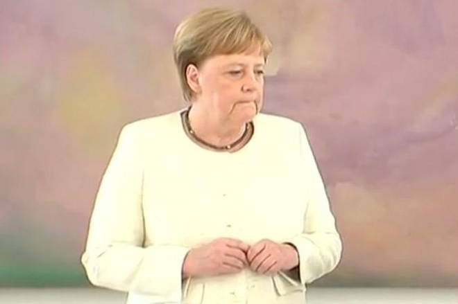 Thu tuong Merkel run lay bay trong su kien cung tong thong Duc hinh anh