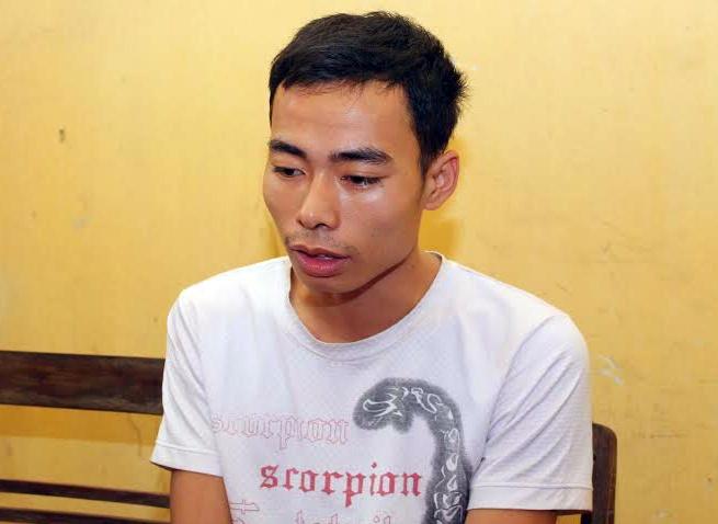 Ga trai co vo bay tinh nu sinh hinh anh 1 Nguyễn Quang Tiền tại cơ quan điều tra. Ảnh: V.Q.