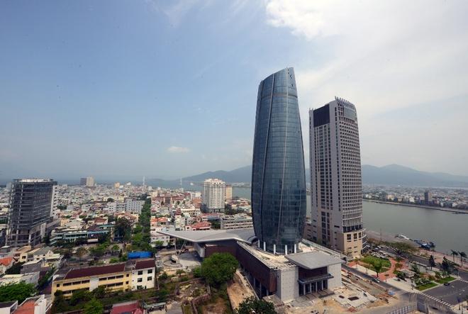 Nhung cong trinh mang dau an ong Nguyen Ba Thanh hinh anh 10 Trung tâm hành chính Đà Nẵng cao 37 tầng, kiến trúc như một ngọn hải đăng hướng ra biển,