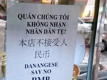 Dan Da Nang treo bang khong nhan tien Trung Quoc hinh anh