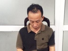 Bat qua tang khach Trung Quoc trom do tren may bay hinh anh 1
