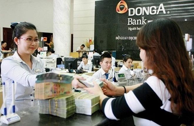Ngan hang Dong A noi gi viec ong Tran Phuong Binh bi de nghi truy to? hinh anh