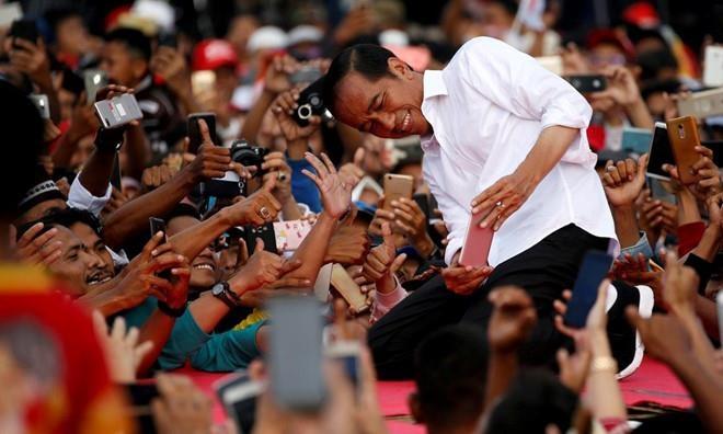 Hau bau cu Indonesia, DSQ Viet Nam khuyen nguoi Viet han che ra duong hinh anh 1