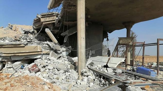 Iraq len an vu My tan cong la nguy hiem va khong the chap nhan duoc hinh anh 2 destroyed_headquarters_of_kataib_hezbollah_militia_group_are_seen_after_in_an_air_strike_in_qaim_2_Reuters.jpg
