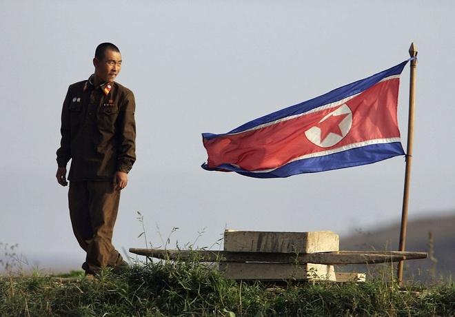 Trung Quoc - Trieu Tien: Qua roi thoi 'nhu rang voi moi' hinh anh