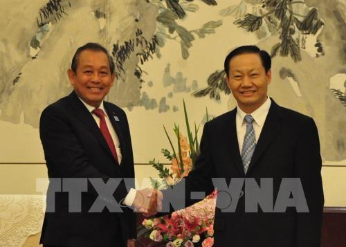 Pho Thu tuong Truong Hoa Binh tiep lanh dao Quang Tay, Trung Quoc hinh anh