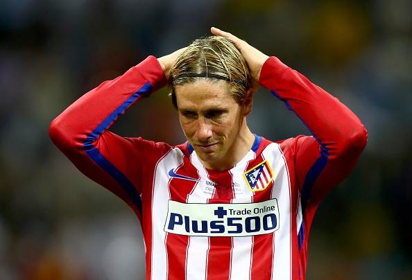 Torres va mot nua thanh Madrid chim trong nuoc mat hinh anh
