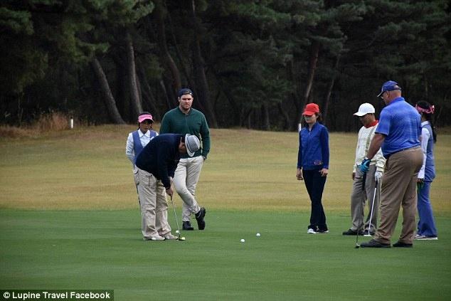 gia mao golf thu sang Trieu Tien thi dau anh 2