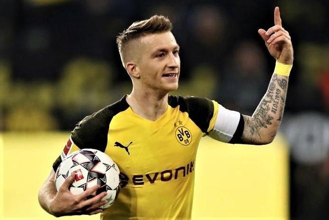 Dortmund vuon len dau bang Bundesliga sau tran thang Augsburg hinh anh
