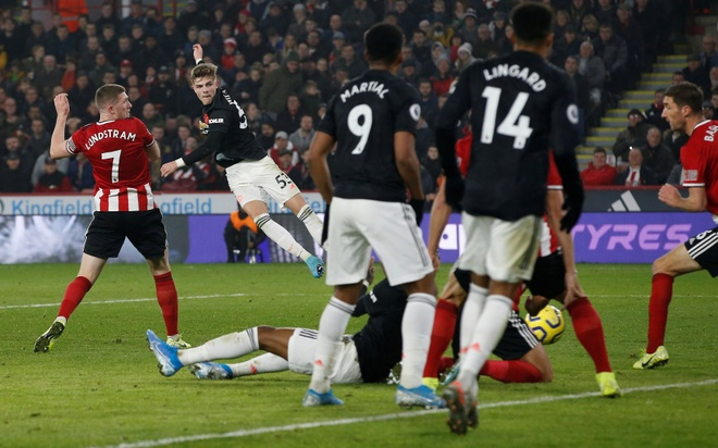 Man Utd chia diem trong tran cau co 6 ban thang hinh anh 2