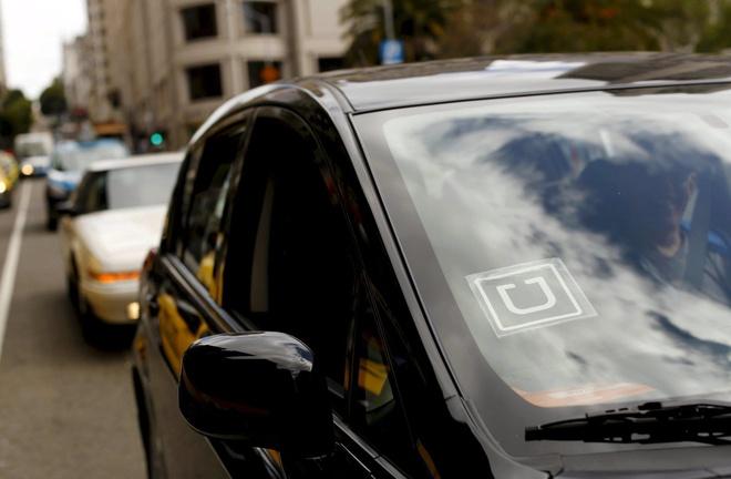 Uber tra 20 trieu USD cho tai xe de dan xep vu kien hinh anh 1