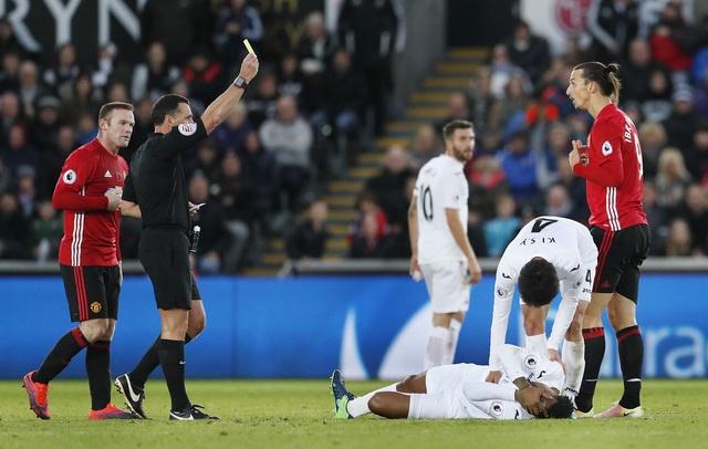 Ibra giai khat ban thang, MU danh bai Swansea 3-1 hinh anh 23