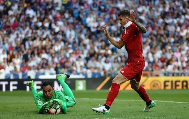 Real vs Sevilla (4-1): Ronaldo lap cu dup hinh anh 10