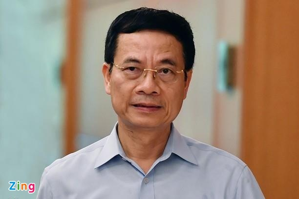 Bo truong Nguyen Manh Hung tra loi chat van truoc Quoc hoi hinh anh