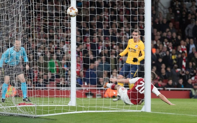 Wenger: 'Arsenal hoa Atletico nhu thua Man United' hinh anh 1