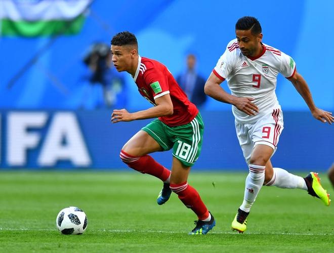 Morocco 0-1 Iran: Hau ve Morocco phan luoi nha dung phut cuoi hinh anh 9