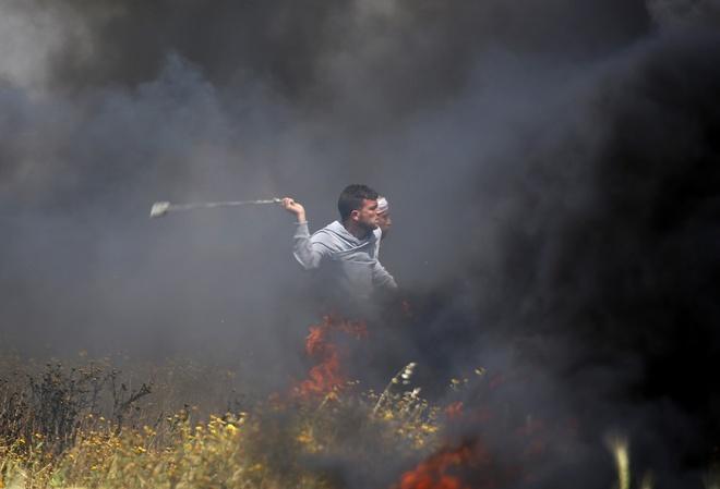 Nguoi Palestine dai bieu tinh o Gaza, 1.400 nguoi bi thuong hinh anh
