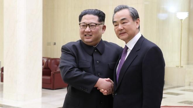 Truoc khi gap Trump, Kim Jong Un that chat quan he voi Trung Quoc hinh anh